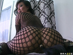 First she shows up wearing nothing but a sexy, see-through fishnet body stocking, and if that's not enough, her friend brings her a new toy to play with.