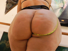 Bodacious Angel Vain squeezes her plump rear into skintight cotton and thin white short-shorts