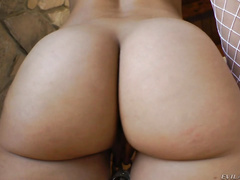 The camera focuses on the juicy asses-in-motion of Holly Michaels (in short-shorts, shiny red latex pants and naked);