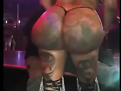 Filming a huge juicy butt in the stripclub